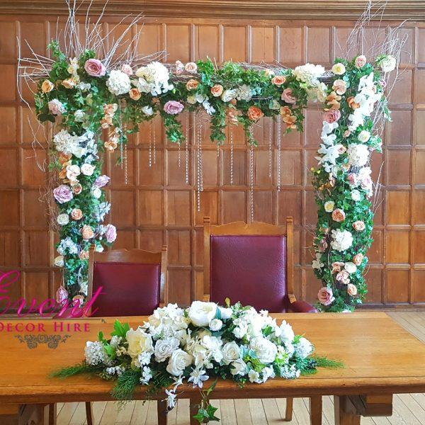 green flower arch ceremony