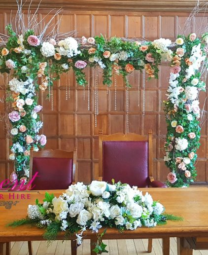 green flower arch ceremony
