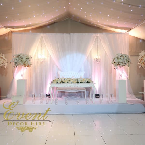 gathered backdrop grecian wedding hire stage design